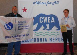 Employees accept CWEA award