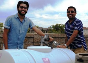 brothers using recycled water fill station